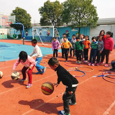 Children practice their ball skills outside the classroom with Projects Abroad volunteers in China